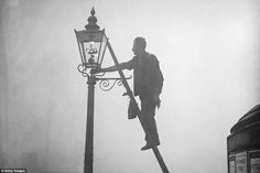 A lamp lighter gets to work in Finsbury Park, London, as the winter nights draw in. It won't be long before our electric street lights brighten up dreary, winter skies after a summer of bright nights. Victorian London, Vintage London, Old London, Vintage Pictures, Old Pictures, Old Photos, London History, British History, Local History