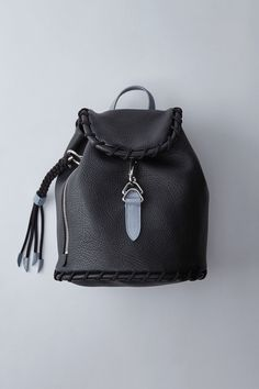 4b4cf56ec97a Acne Studios Rope Jungle black light blue is a small leather backpack with  large whipstitch details perfect for daily use