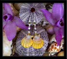 How Sweet are these for Springtime! Colorful Swarovski Crystals and Freshwater Pearls drop to a sparkling pair of Sunrise Shells! Full of Joy and fun to wear, on sterling silver French earwires, dangle length of the earrings is 2 1/2 inches. Unique, natural beach and gemstone jewelry hand crafted with the finest shells in Hawaii.