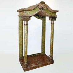Italian Painted Teak Temple Niche  Hand crafted of pine with a faux marble, painted finish in tones of rust and olive, this gracefully conceived piece features a scrolled, hipped room, capped with a carved shell, and plain columns in somewhat Doric fashion. It is of a generous size and offers many possibilities for creative uses. The back could be finished, and with glass shelves, it would make a great display case. circa 1820