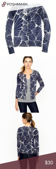 J. Crew Fanfare Cardigan PRODUCT DETAILS Our designers discovered this abstract print during an inspiration trip to Miami and were immediately enamored with its '60s feel. Spun from our famous 14-gauge merino wool (the higher the gauge, the more refined the fabric), this retro-done-right print will be in heavy rotation throughout the sunny months. EUC with no flaws/signs of wear.   Hits above hip. Long sleeves. Hand wash. Import. Item 67656. J. Crew Sweaters Cardigans