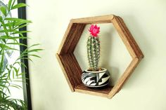 Add some mid-century charm to your gallery wall with this DIY wall art idea. All you need is popsicle sticks, glue and some stain to make this inexpensive home decor knockout. Click to see the full tutorial and download the free hexagon template. | MakeAndDoCrew.com