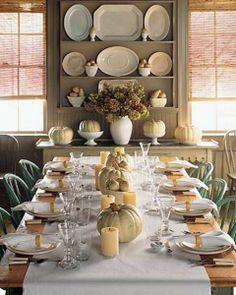 Lots of Thanksgiving decorating ideas. Centerpieces, fall table setting and more.  I like the old platters on the wall.