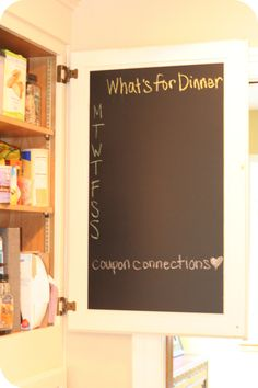Chalkboard paint inside kitchen cupboard! - this is a great idea because I like the idea of a menu board but don't have a great wall space to put it.