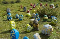 Prayer stones decorate the colourful Buddhist academy, which is only accessible by a long coach journey