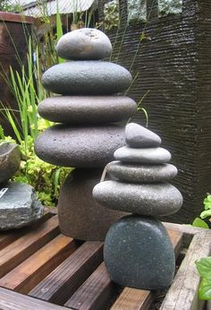 Cairn - Stacked rock cairns in various sizes add a Zen element to the garden or home. These rock sculptures are symbolically used by cultures throughout the world to mean various things – from a memorial marker to a spiritual temple.: