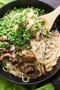 Vegan Spaghetti Carbonara - Smoky marinated cremini mushrooms and peas are tossed with spaghetti in a silky tofu and cashew sauce to create this decadently delicious vegan carbonara.