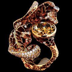 1 cognac diamond 3,52 ct  88 diamonds 0,52 ct  102 cognac diamonds 0,56 ct  89 champagne diamonds 0,51 ct  18K yellow gold 13,2 g