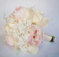 This ivory and blush peony, hydrangea, rose and calla lily wedding bouquet is soft and romantic. Silk ivory hydrangeas and roses, and real touch ivory calla lilies are accented with soft blush pink pe
