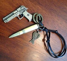 Car Accessories, Rearview Mirror Charm, Biker Keychain, Cowboy Bullet and Revolver Car Charm for all Automobiles on Etsy, $21.00