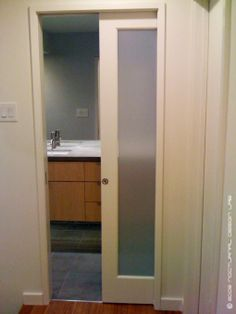 Pocket doors doors and frosted glass on pinterest for Modern glass pocket doors
