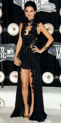 Selena Gomez in a Julien Macdonald dress, gold Ofira cuff, Judith Leiber miniaudiere and leather Brian Atwood pumps.