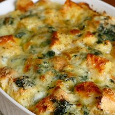 Spinach and Cheese Strata Recipe Breakfast and Brunch, Main Dishes with unsalted butter, onions, frozen chopped spinach, salt, pepper, grated nutmeg, italian bread, gruyere cheese, grated parmesan cheese, large eggs, milk