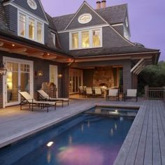 This lap pool looks too close to the house living space.  like the sloping roofline and the outdoor fireplace, though.