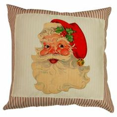 "Celebrate the holidays in vintage-inspired style-with red striped ticking and a canvas patch, this charming pillow showcases a classic Santa Claus motif.  Product: PillowConstruction Material: Cotton canvas and linenColor: CreamFeatures: Insert includedDimensions: 20"" x 20"""