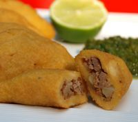 These appetizer-size empanadas have a cornmeal crust and tasty filling made of beef and potatoes.
