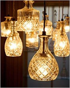 Crystal decanters used as light fixtures - perfect for high ceilings and to add instant style and class