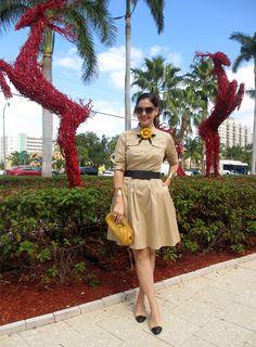January 16, 2013  http://www.akeytothearmoire.com/post/40678735796/an-arresting-outfit  #khaki #shirtdress #Chanel #camellia #camellia pin #camellia brooch #bow belt #Ralph Lauren #Prada #Chanel flats #Chanel ballerina shoes #Cole Haan #yellow #black #pierced cuff bracelets #chic #elegant #ladylike #preppy #full skirt #dress #casual #gold