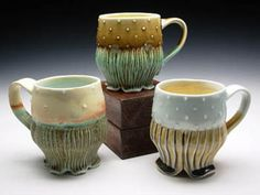 Beautiful. Love the detailed feet on these mugs
