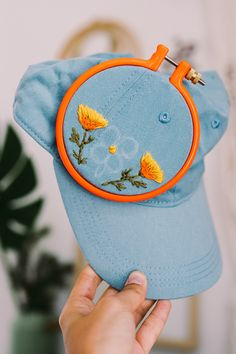 Ribbon Embroidery Patterns Custom embroidered hats by Lexi Mire // hand embroidery - Lexi Mire unexpectedly tapped into a market for custom embroidered hats. Learn how her business is booming and she stays sane despite the popularity. Hat Embroidery, Learn Embroidery, Hand Embroidery Stitches, Hand Embroidery Designs, Embroidery Techniques, Cross Stitch Embroidery, Embroidery Ideas, Hand Stitching, Knitting Stitches