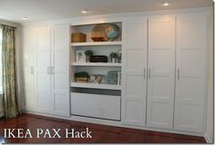 ikea pax hack for wardrobe with built in look, possibly tv in center instead of display .
