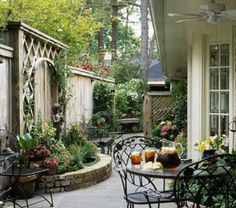 Small backyard spaces....I think we should just cement our sad backyard  something like this.