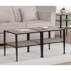 @Overstock - A weathered grey wood and a powdercoated metal finish highlights this cocktail table. Multiple tables can be grouped, allowing you to create a larger coffee table from two or more smaller units.http://www.overstock.com/Home-Garden/Shuffle-Cocktail-Table/6434392/product.html?CID=214117 $55.99