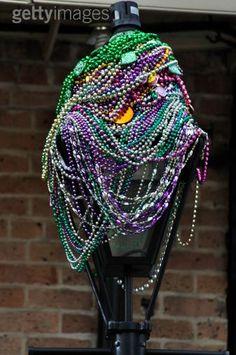 A Nola Mardi Gras light - after a Mardi Gras parade