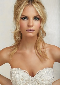 Her hair is simple and elegant. Natural wedding makeup...I like this a lot with maybe a slightly darker lip