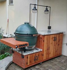 Big Green Egg barbeque table. Cedar and granite with gas pipe lighting, electric outlet box with USB and light switch.