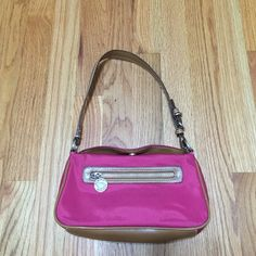 Pink Tommy Hilfiger Purse Pink and tan Tommy Hilfiger purse. Inside has one small pocket about the size of a credit card to slide items in. Outside has a zippered pocket. Top folds over and snaps shut with a magnetic snap. Tommy Hilfiger Bags Mini Bags