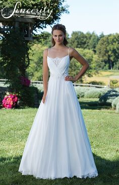 A chiffon gown made even more romantic by spaghetti straps, illusion bodice with illusion lace in the back, and simple skirt.