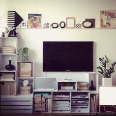 DIY shelves of IKEA boxes by perfectionmakesmeyawn.com