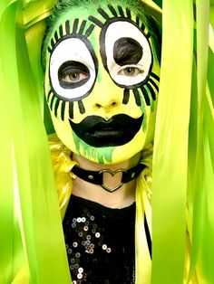 Club Kid drag queen freaky large eye bright fluorescent colours yellow green black glitter cartoon makeup. Lacey Lou