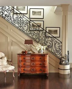If ever I grow up to be rich and elegant... this is what I want my stair rail to do: Wrap a round a beautiful column at the base of the stairs.