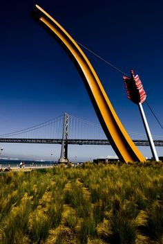 Cupid's Span Sculpture(by Claes Oldenburg)  and Bay Bridge on San Francisco's Embarcadero California via flickr