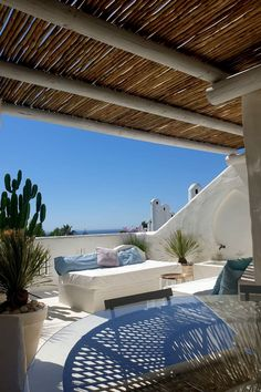 Whitewash lath pergola and seating area is the perfect spot for afternoon siestas!