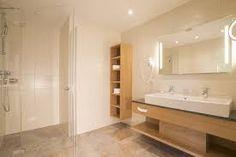 Afbeeldingsresultaat voor bruine tegels in douche