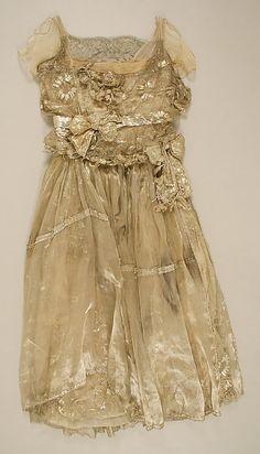 Evening dress Designer: Lucile Date: 1910s Culture: British Medium: metallic thread Accession Number: 1995.294