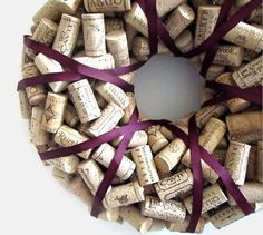 Wreath of Wine Corks ~ Like the burgundy colored ribbon used for trim!