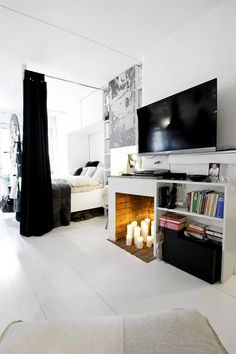 Nice #B apartment bedroom made warm with a candle-lit fireplace, realistically speaking, where's a girl to find firewood in the city?