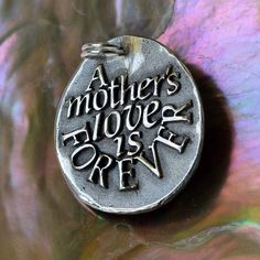A mother's love is forever - Give away price ... Inspirational Quote on Silver Pendant