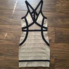 Tan and black bandage dress Sexy satrapy dress thick sweater material with stretch. Like new condition worn once bebe Dresses Mini