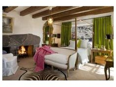 Love the masculine rustic textures mixed with the feminine white and traditional pieces and the pops of green.