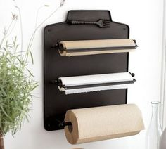 roll organizer in a pantry for wax paper, aluminum foil etc