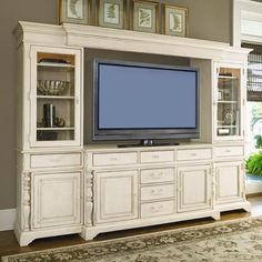 """{ I love this rustic wood tv / entertainment console / shelving unit / Bombay / buffet in this luscious white """"linen"""" shade it looks vintage and classic! Can you imagine a southern style super bowl celebration in front of that tv?!} Paula Deen by Universal Paula Deen Home Entertainment Console Wall Unit at Baer's Furniture"""