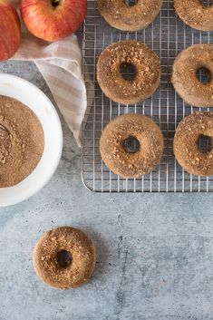 Apple cider donuts made with oats, almond butter, and apple cider finished with a refined-sugar-free coconut sugar, cinnamon, and apple chip dusting. Enjoy these Vegan Apple Cider Donuts as a fun fall dessert, snack, or breakfast. They look and taste like dessert but are actually packed with fiber, protein, and complex carbs. | Vegan Healthy Lifestyle | Flora & Vino | Whole Food Desserts, Vegan Dessert Recipes, Vegan Sweets, Vegan Snacks, Whole Food Recipes, Vegetarian Recipes, Cinnamon Sugar Apples, Cinnamon Apple Chips, Apple Cider Donuts