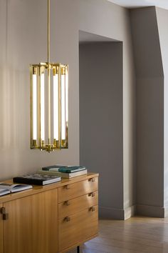 Chandelier 11 by Magic Circus is inspired by the Art Deco movement. It plays with and accentuates light, the rectangular brass tubes producing a succession of mirror effects.