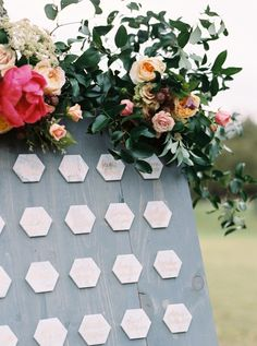 Hexagon place card display http://www.stylemepretty.com/2016/04/15/outdoor-wedding-with-show-stopping-florals/ | Photography: Apryl Ann -  http://www.aprylann.com/