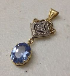 #WeBuyGoldBoutique ~ Ladies Estate 14K Yellow Gold/White Gold Blue Oval Topaz and White Sapphire Pendant. Sold for $129.00 in our eBay store thejewelryboutique0321 or visit www.WeBuyGoldBoutique.com to view & bid on more stunning estate jewelry.  #Gold #Pendant #BlueTopaz #WhiteSapphire #Estate #Unique #Jewelry #FineGold #Stunning #FineJewelry #Boutique #NashvilleFleaMarket #Vintage